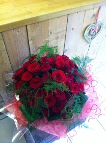 Deluxe hand tied bouquet of Red Roses.