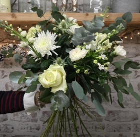 Ivory and white hand tied bouquet presented in a gift box in water.