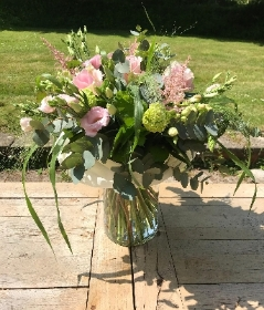 Luxury hand tied arrangement in pretty pinks in a stylish vase.