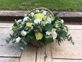 Basket arrangement in yellow, cream and white.
