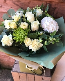 White, cream and green hand tied bouquet presented in a gift box in water.