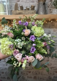 Country garden hand tied bouquet in a vase.