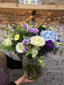 Pretty hand tied bouquet in a vase.