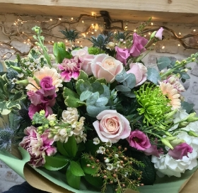 Pretty hand tied bouquet, large in size in an included eco vase.