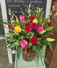 Large vibrant hand tied bouquet in an included eco vase.